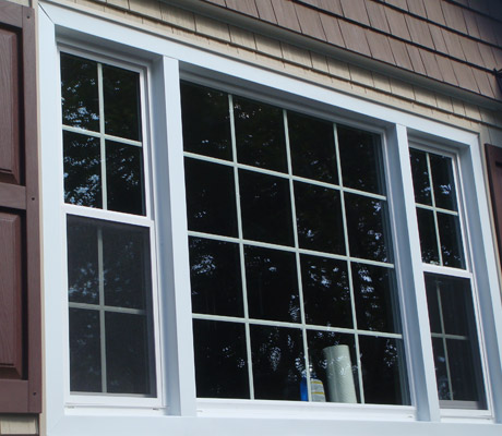 Aluminium window trim with vinyl j-channel