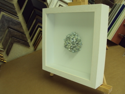 we have experience in framing a variety of three dimensional work and we have developed a variety of methods to ensure the objects stay put