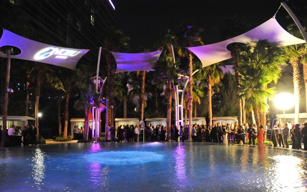 10_08_13_Guests-surrounding-Breathe-Pool-Photo-Credit-Patrick-Gray-1024x641.jpg