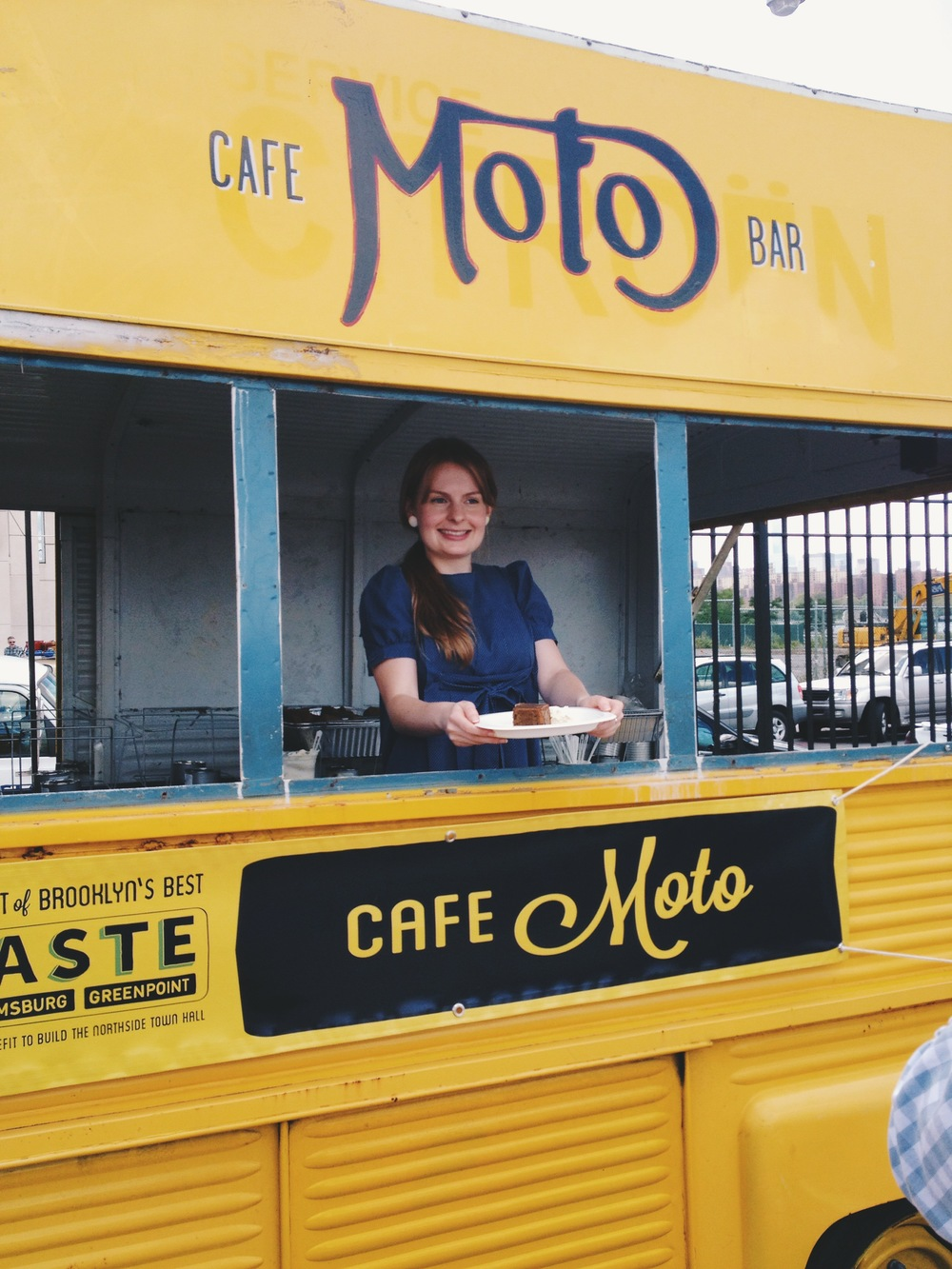 Emily serving up Moto's famous date cake