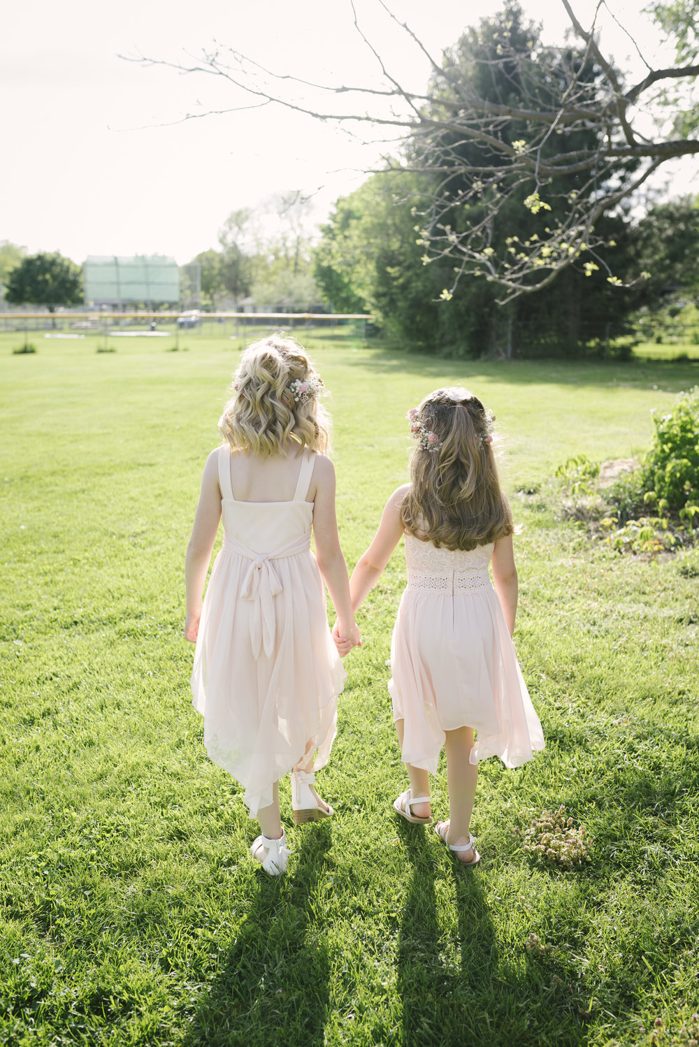 Flower girls walking for their photo debut