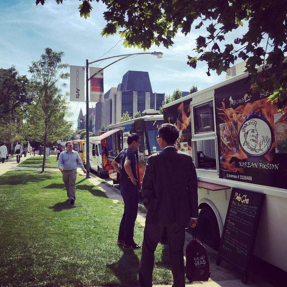 Food trucks prepare for the lunch rush on the University of Chicago campus.