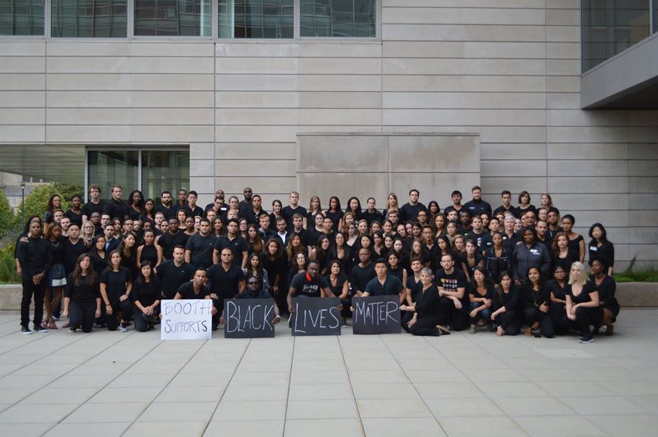 Photo Caption: Just back from summer break, dozens of Booth students, organized by AAMBA and HABSA co-chairs, came out to support the Black Lives Matter initiative on Friday Sept 23rd.