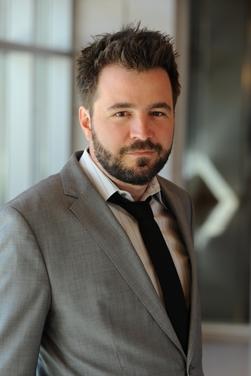 Professor Emir Kamenica