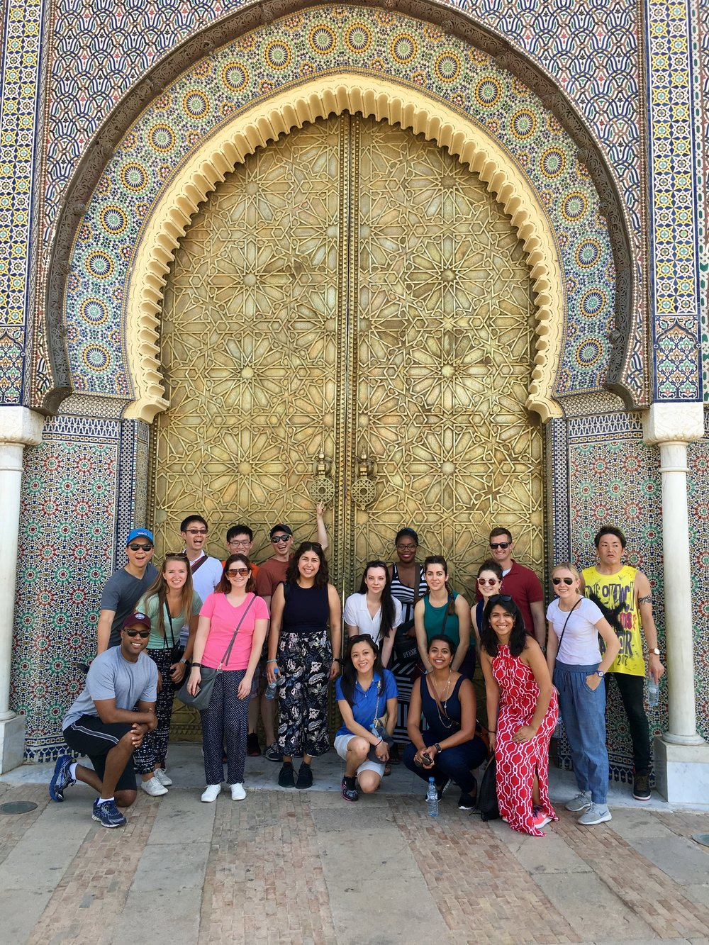 Group poses in front of one of the beautiful doorways of Fez