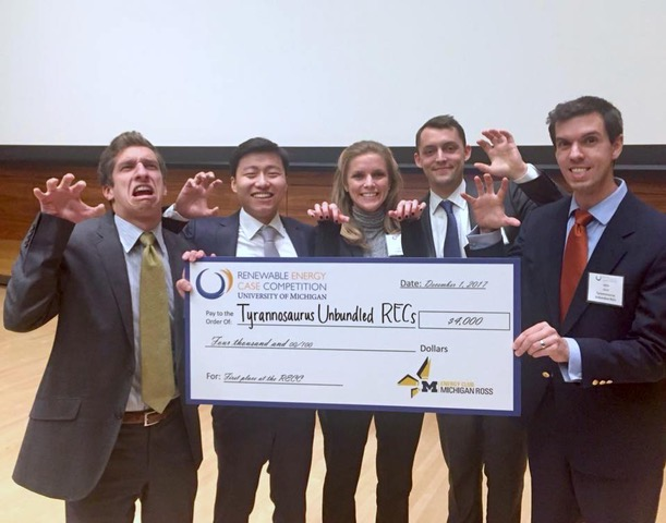 The Booth Team, Tyrannosaurus Unbundled RECs, represented by Rachel Enright, Conor Coughlin, Richard Yin, Louis Ernst, and John Chiulli, pose with their winning check at the Ross Renewable Energy Case Competition