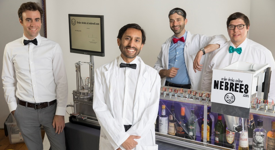From left to right, Mark Stevens, Sagar Mittal, Will Fischer, and Travis Briggs take a break to pose for a photo while trying to disrupt the long-range alcohol dispensing industry.