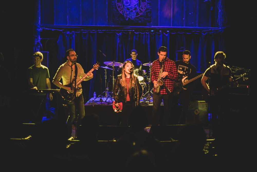 Ida Noise rocked the house with hits like X's and O's, Gold on the Ceiling, and Rolling in the Deep. From left to right, keyboardist Matt Bernstein, guitarist Nick Balay, lead singer Michelle Kim, drummer Ahmed Abdulsalam, John Chiulli on sax, Roi Kessler on bass, and virtuoso Chris Liquin on guitar and trumpet.