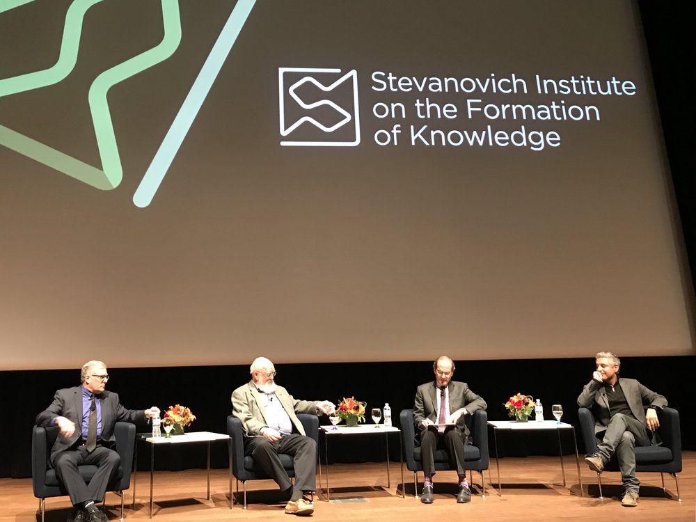 The panelists engage in a spirited discussion, moderated by Professor Nirenberg