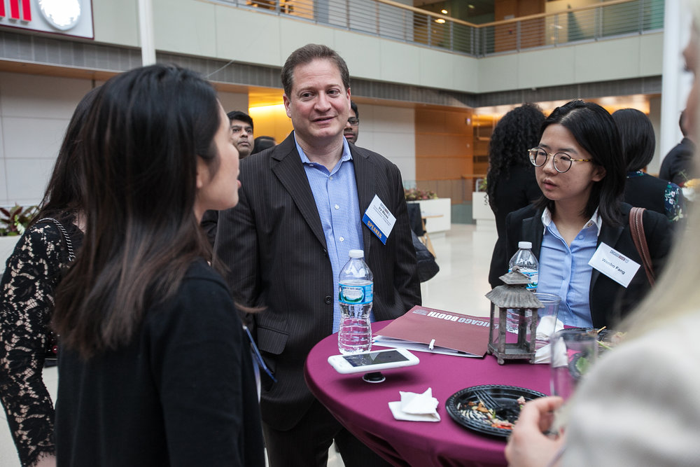 Students and speakers have spirited discussion during the reception at last year's Emerging Markets Summit