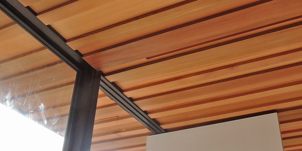 We've used six different profiles of dressed Western Red Cedar in this ceiling / soffit.  Slot recesses are for soon to be installed strip LED lights.