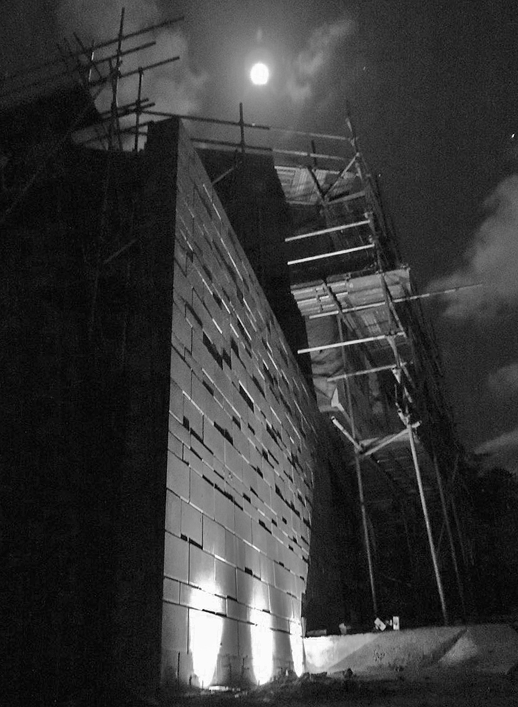 Scaffolding, tarps, a construction site, a full(ish) moon, and some iPhone lighting...  eerie.