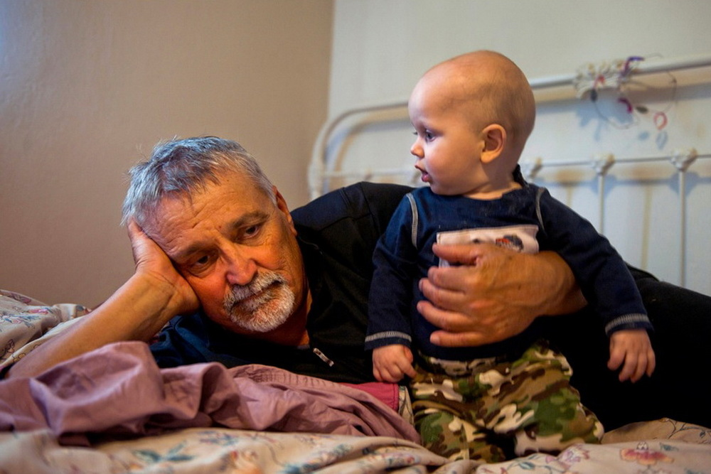 "2013 Pulitzer Finalist ""A Grandfather's Sorrow and Love."" Don Hatfield, 64, snuggles his grandson Alex, the youngest of three children of his daughter Rachel Winkler who was killed Feb. 27, 2012, in her Cameron Park, California home. © Renée C. Byer/Sacramento Bee/ZUMAPRESS.com"