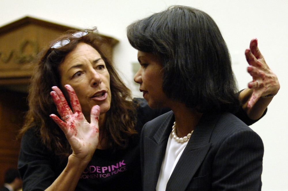 US Secretary of State Condoleeza Rice is accosted by Code Pink protester Desiree Farooz who had simulated blood on her hands just before the Secretary was to give Testimony on the U.S. Middle East Policy before the House Foreign Affairs Committee. Oct 24, 2007  ©Louie Palu/ZUMAPRESS.com