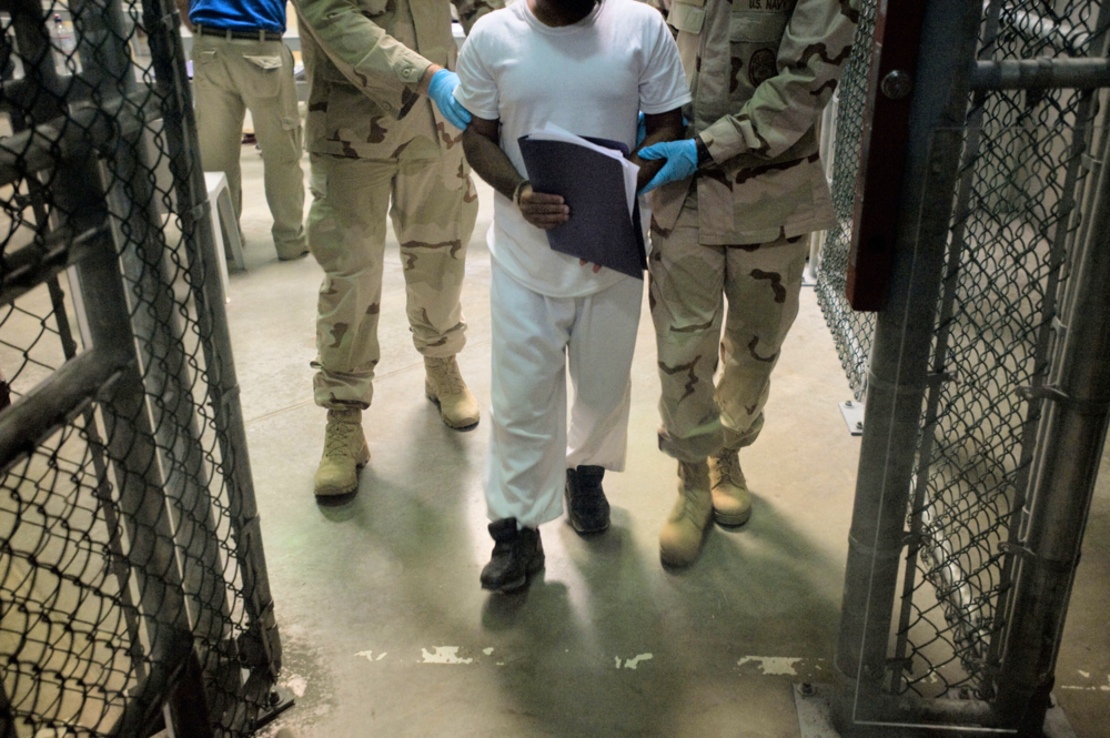 A shackled detainee is moved out of a pod by camp guards in Camp 6 at the Guantanamo Bay Detention Facility. Mar 30, 2010   ©Louie Palu/ZUMAPRESS.com
