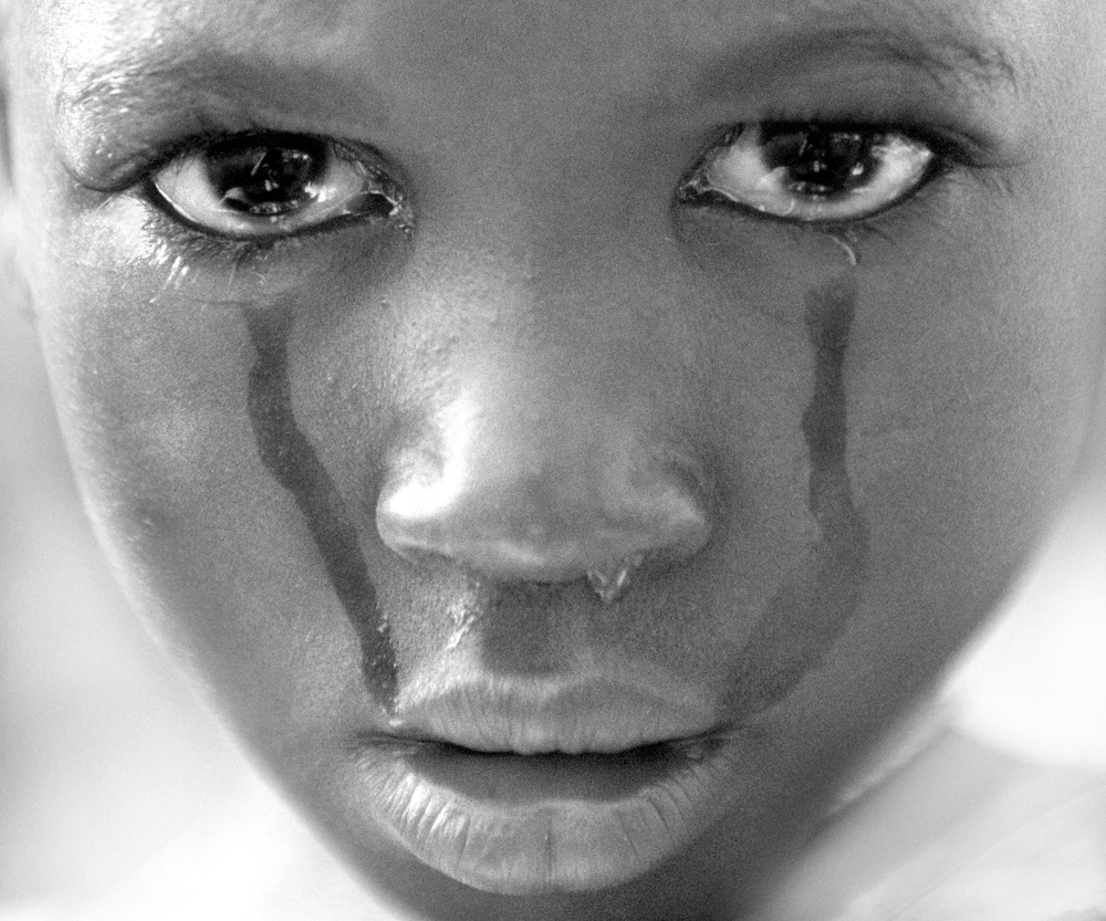 Awa Balde, 5, cries after being circumcised. This is one of two images misappropriated by the  #bringbackourgirls  campaign. Guinea Bissau 2001   © Ami Vitale