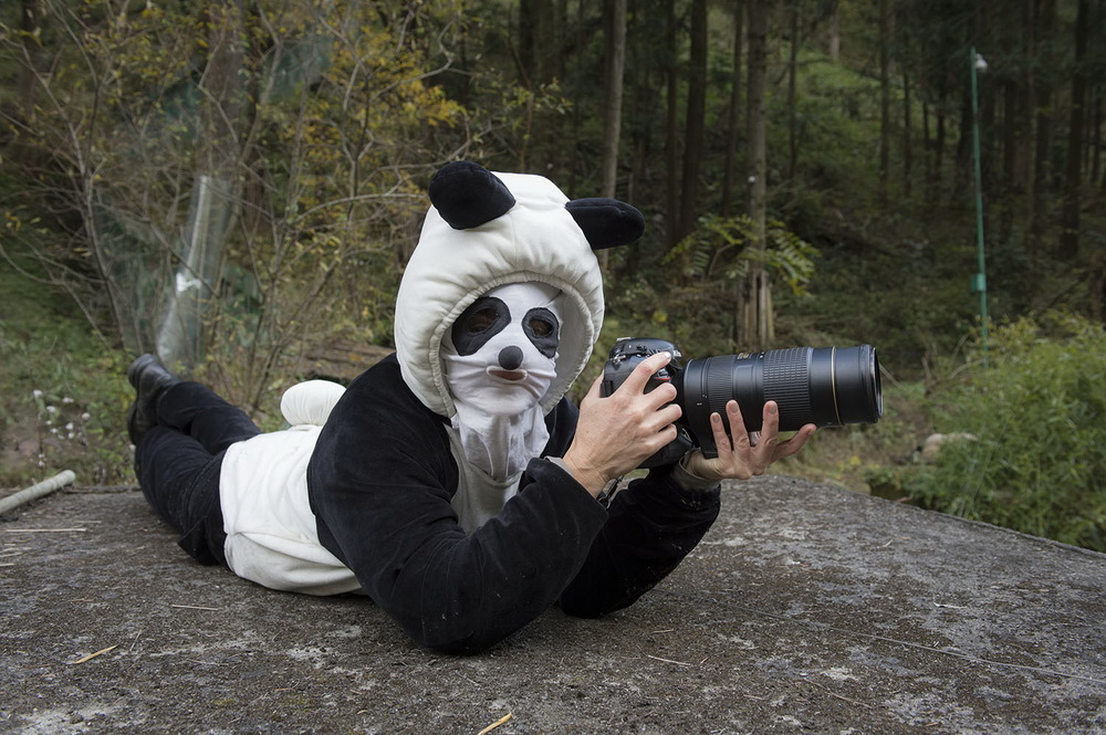 Ami Vitale  dressed as a panda at China's Wolong National Nature Reserve, in Sichuan province. 2013   © Ami Vitale