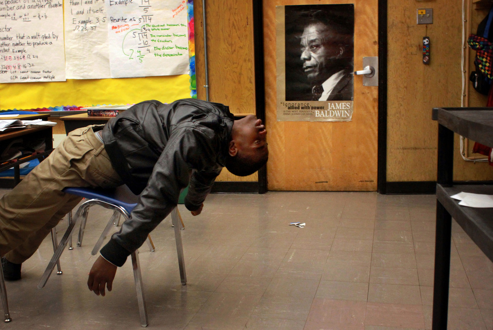 Sixth-grade student Jayden Brumfield acts exasperated as teacher Peter Wilson assigns homework. The children that were chosen to attend the 100 Black Men Charter School were students who acted out or had learning disabilities that the other schools in the district did not want. © Lacy Atkins/San Francisco Chronicle