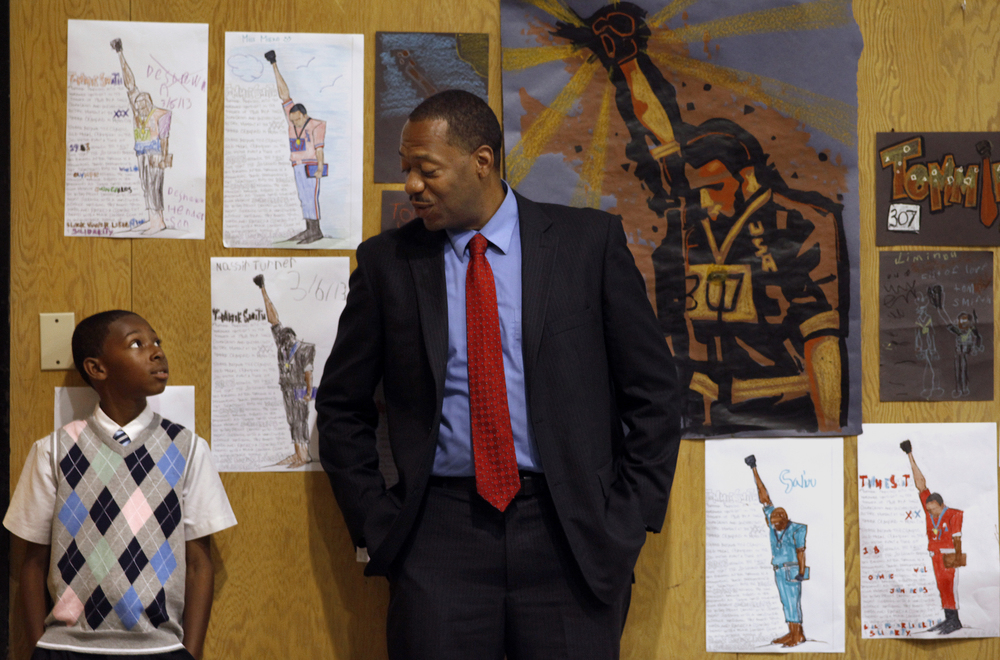 Fifth-grade student Joshua West listens to principal Dr. Stanley Johnson as he talks to him about his behavoir while standing among drawings of Tommie Smith, an African American athlete who is known for giving the Black Power salute at the 1968 Olympics. He visits the students at their school once or twice a year. © Lacy Atkins/San Francisco Chronicle