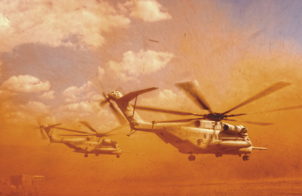A Marine CH-53E helicopter from the 464th Alpha Company blows sand and rocks as it takes off in Harar, Ethiopia. 2005. © Stacy L. Pearsall
