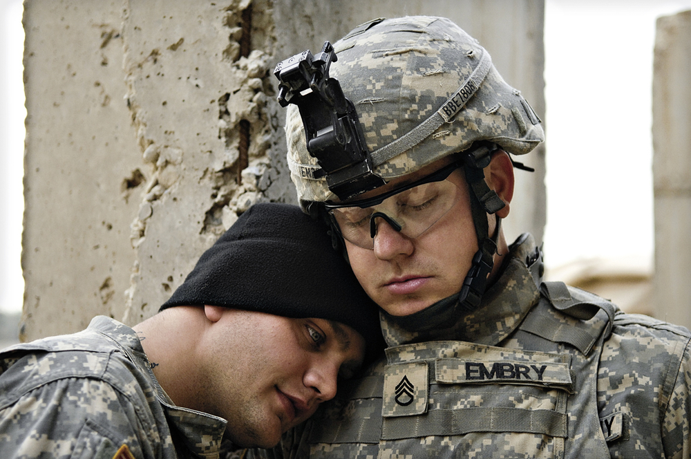 U.S. Army Staff Sgt. Branden Embry embraces his battle buddy after a grueling combat operation in Diyala Province, Iraq. 2007 © Stacy L. Pearsall
