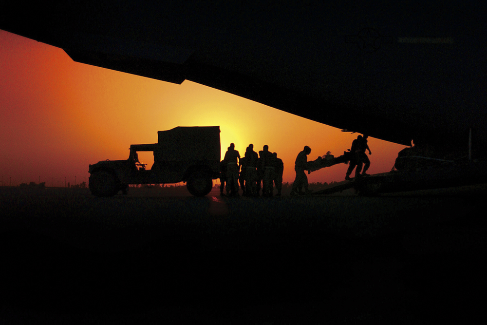 U.S. Air Force Airmen transfer wounded military personnel from an ambulance to a C-17 Globemaster III aircraft in Baghdad, Iraq. 2003 © Stacy L. Pearsall