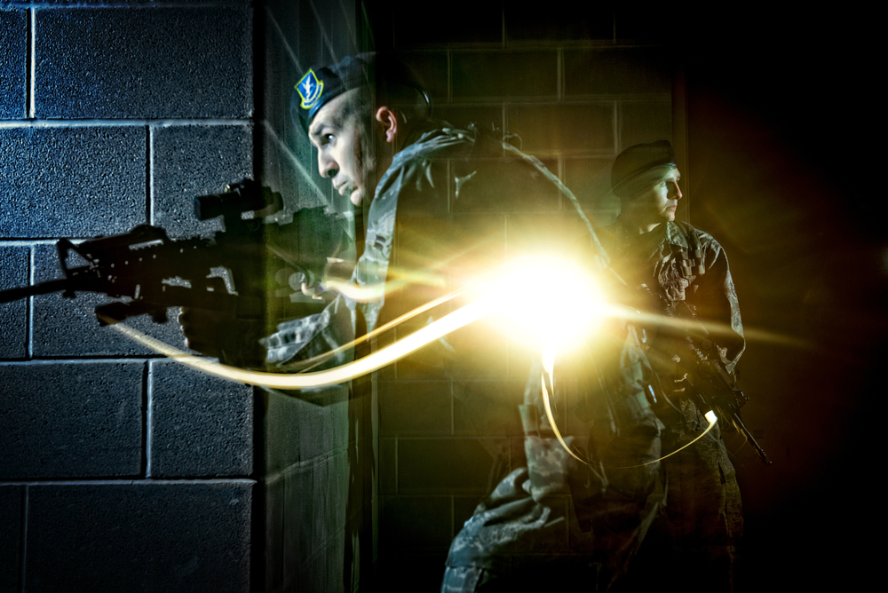 An Air Force Security Forces member tactically moves through the hallway of a dark building during clearing operations training in San Antonio, Texas. 2013 © Stacy L. Pearsall