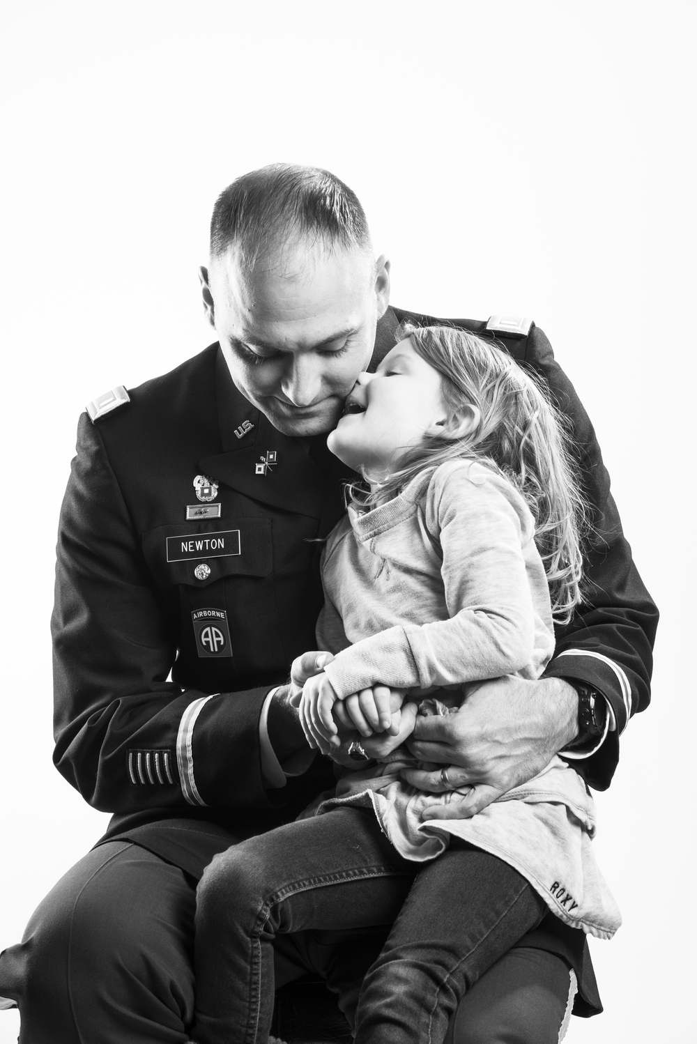 "U.S. Army First Lieutenant Martin K. Newton began his career as an enlisted combat photographer in 1994, after which time he deployed to Afghanistan and Iraq. After two deployments, he married in 2009 and his daughter, Bella, was born later that year. In light of making the military a lifelong career, Newton finished his degree in 2010, was commission as an officer and deployed once again to Afghanistan. ""Serving my country means I'm part of a very small number of people who have chosen to serve their country no matter what the circumstance,"" explains Newton. 2013 © Stacy L. Pearsall"