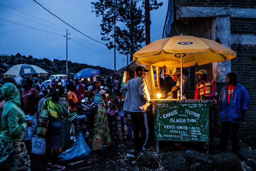 Goma residents shop and charge their cell phones during the evening. Democratic Republic of Congo 2013 © Pete Muller for the New York Times