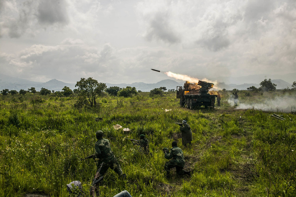 Congolese forces fire rockets toward M-23 rebel positions north of Goma. Democratic Republic of Congo 2013 © Pete Muller for the New York Times