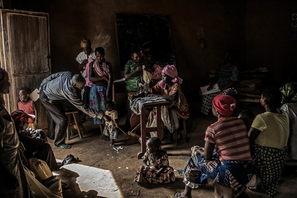 Residents gather inside a makeshift sewing studio in the village of Mangango, in the eastern Democratic Republic of Congo, on Monday, March 3, 2014. A nod to Caravaggio.  © Pete Muller/Prime for the Nobel Women's Initiative