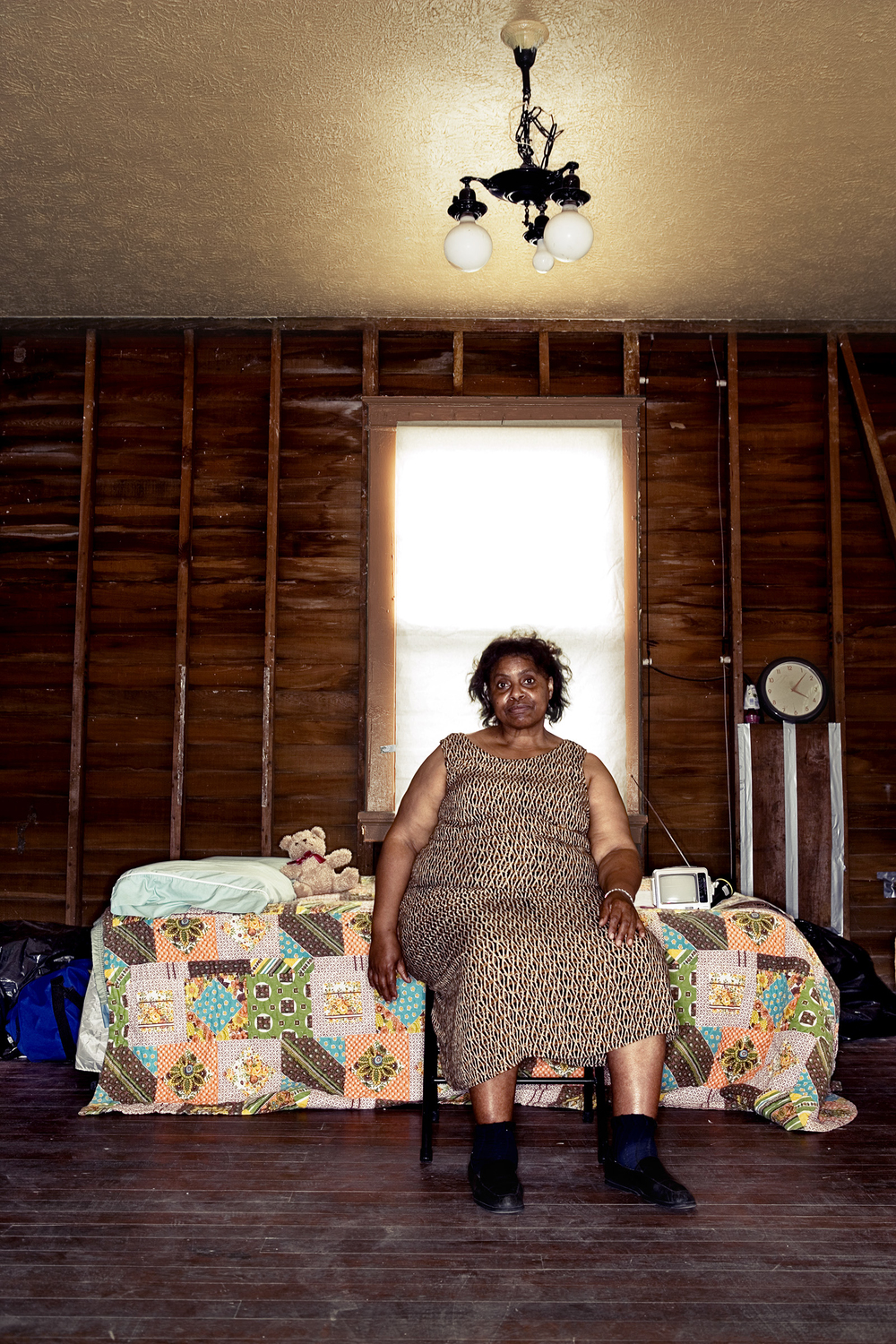 Post Hurricane Katrina: Carolyn on bed  © Stephen Wilkes