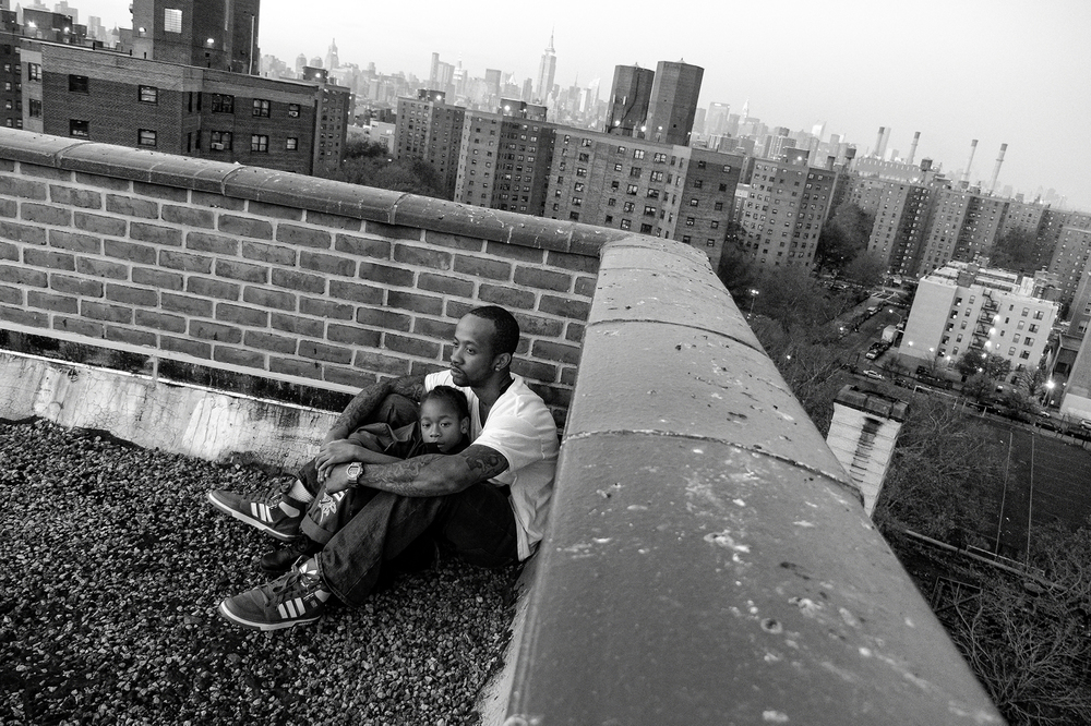 Jerell Willis and son Fidel on the rooftop of their apartment building, which often serves as a retreat from the city's hectic pace. 2011 © Zun Lee