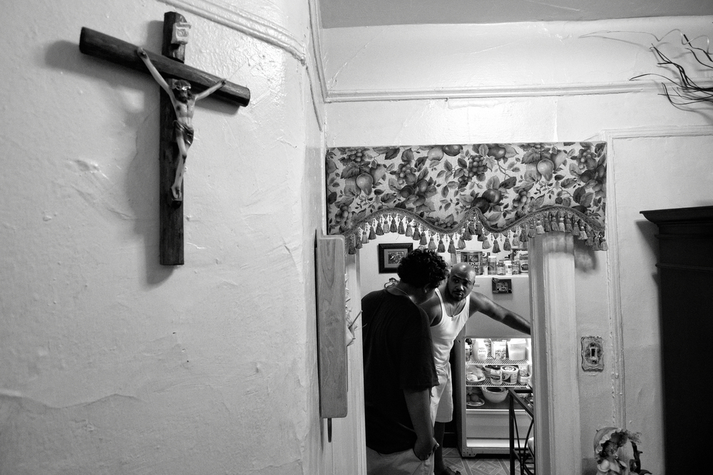 Billy Garcia and his son Jeremy debate what to prepare for dinner. 2012 © Zun Lee