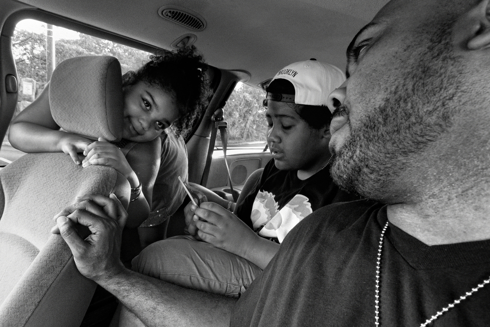 Esmeralda Garcia teases her father Billy as the family is about to drive to their favorite dinner hangout. 2012 © Zun Lee