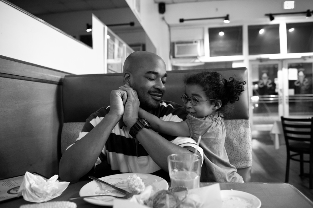 Carlos and Selah Richardson relax after dinner at Soul Vegetarian Restaurant. Atlanta, GA. 2012. © Zun Lee