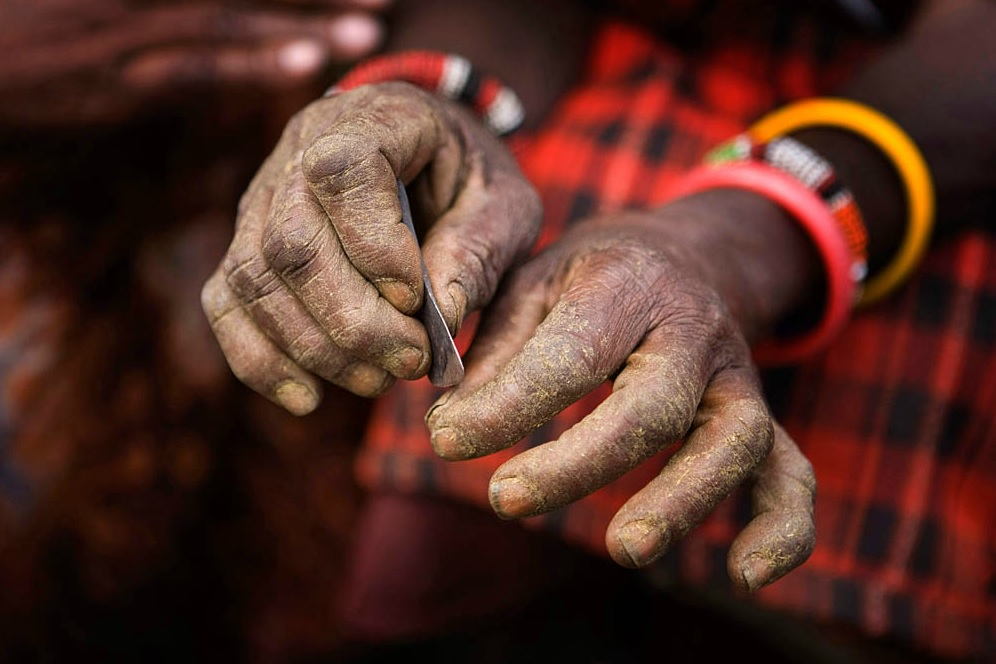 Traditional Blade:  Kameli, Kenya. A Maasai villager displays the traditional blade used to circumcise young girls before the practice became illegal in Kenya. © Marvi Lacar