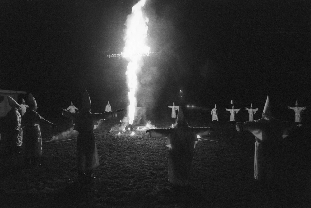 Members of Ku Klux Klan at a night ceremony in  Dunham Springs, LA. December, 1976  © Jean-Pierre Laffont