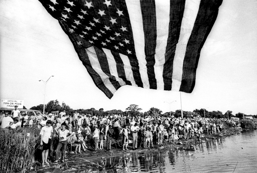 A crowd gathers to watch the Launch of Apollo XI at Kennedy Space Center. Apollo XI was the spaceflight that landed the first humans on the moon. July 16, 1969 © Jean-Pierre Laffont