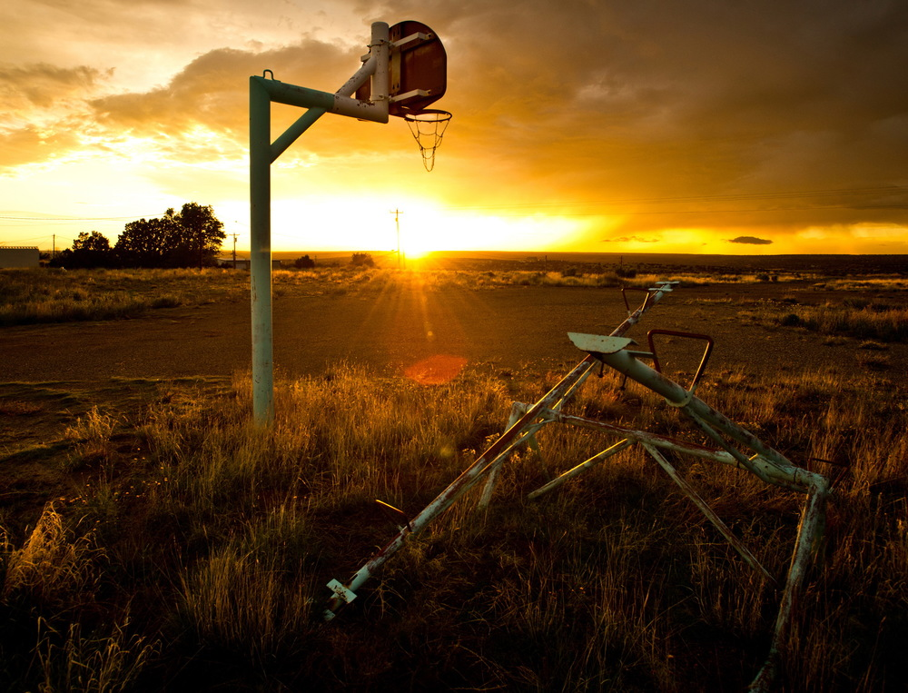Sun sets on an old basketball hoop in New Mexico © Rob Hammer