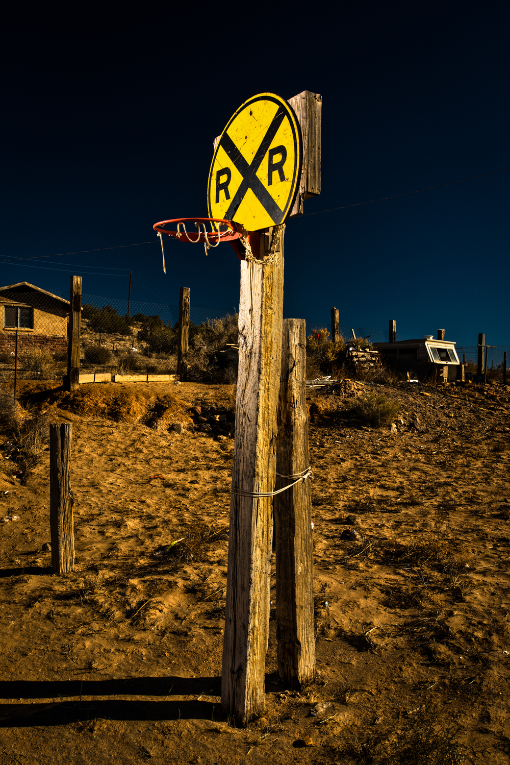 Railroad crossing sign as a backboard in New Mexico © Rob Hammer