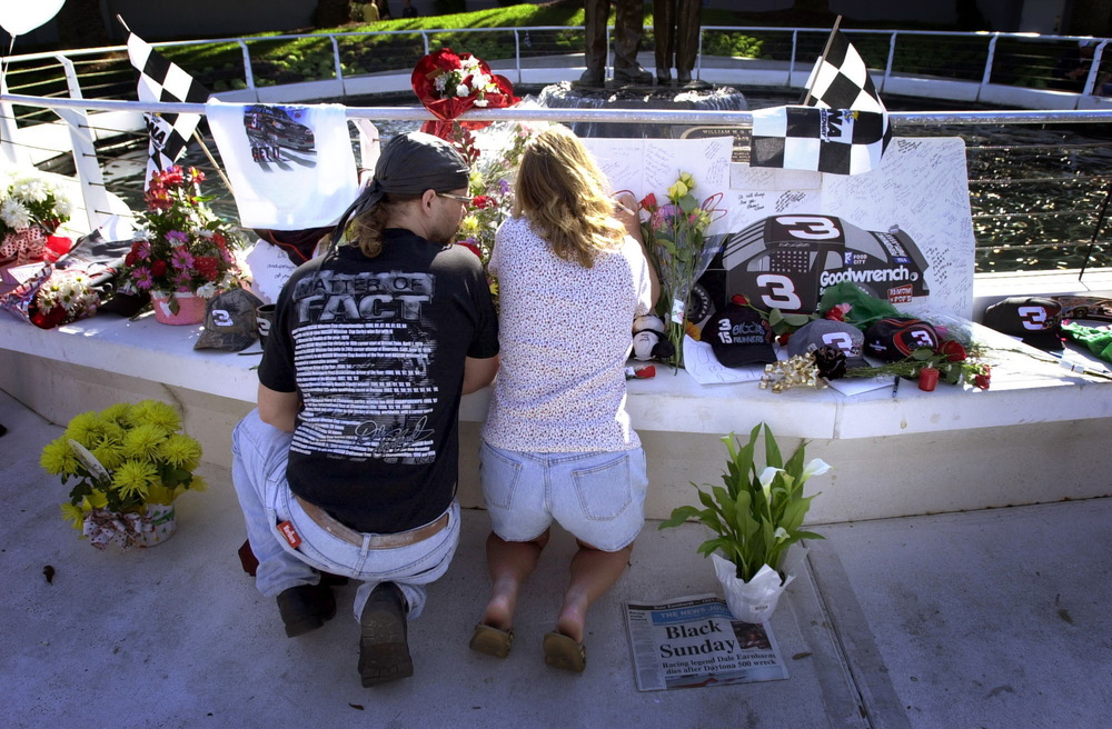 Two fans at a makeshift memorial for Dale Earnhardt who was killed during a crash on the last lap of the Daytona 500. February 19, 2000 © David Bergman for Sports Illustrated