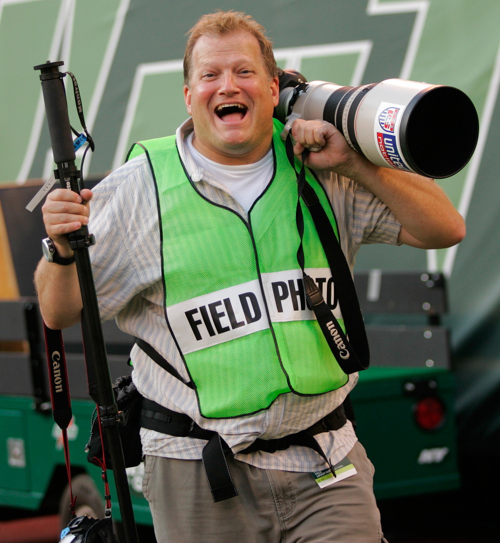 Comedian Drew Carey works the sidelines at a Jets v Dolphins game. September 18, 2005 © David Bergman