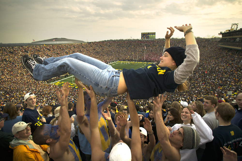 Michigan freshman Diana Schorry, 18, gets tossed after Michigan scored against Ohio State with 7:55 left in the fourth to go up 35-21 at Michigan Stadium in Ann Arbor. November 22, 2003 © David Bergman