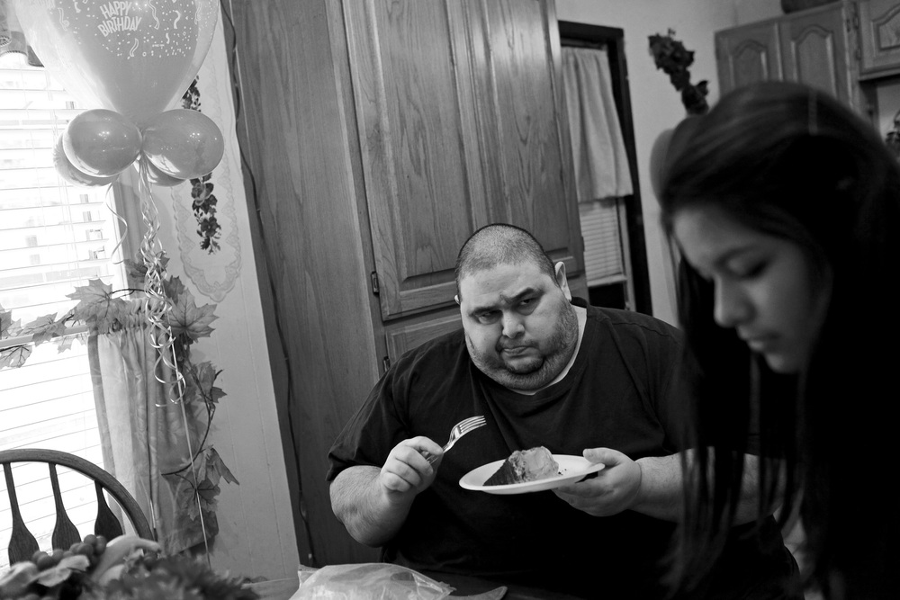 Hector Garcia Jr. is skeptical of the sugar-free cake his mother bought for him as he celebrates his 45th birthday with his niece, Lauren Ibarra.  © Lisa Krantz/San Antonio Express-News/ZUMA Press
