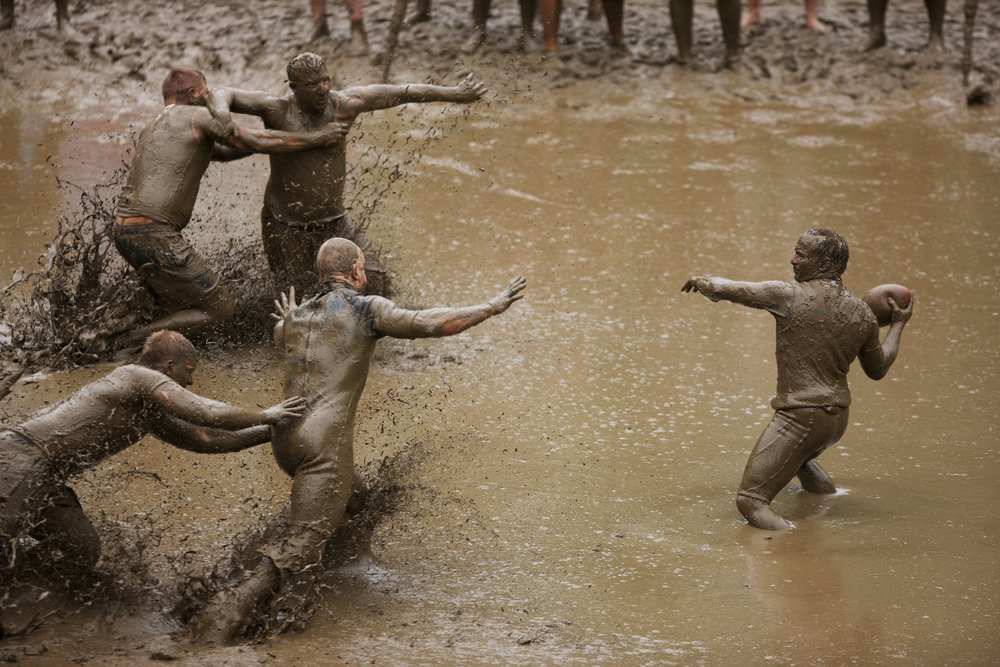 The annual Mud Bowl held at Hog Coliseum has been called the cleanest sport ever played in knee-deep mud. © Sol Neelman
