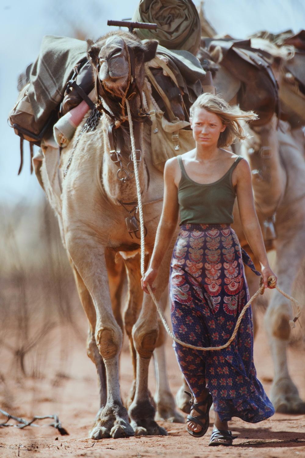 Robyn (Mia Wasikowska) leads her camels.   ©   Matt Nettheim/See-Saw Films