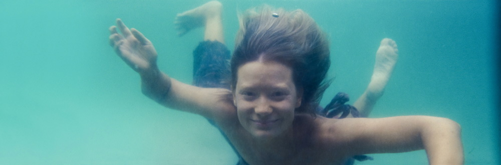 Robyn (Mia Wasikowska) swimming towards the camera in the closing scene of the Tracks movie.   ©   Mandy Walker, TRACKS Director of Photography