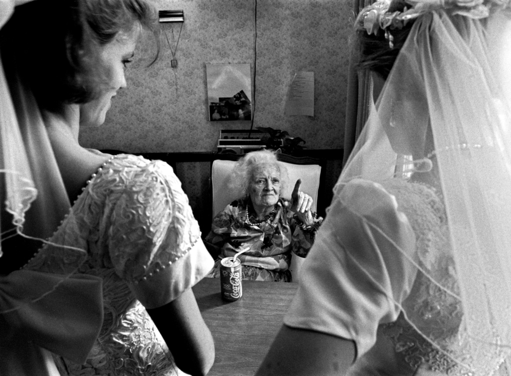 This was not a lesbian wedding, but two sisters having a double wedding. Before the ceremony they went to visit their grandma in a nursing home. It was kinda like an inspection. I like capturing these moments in life. © Nancy Andrews/The Washington Post