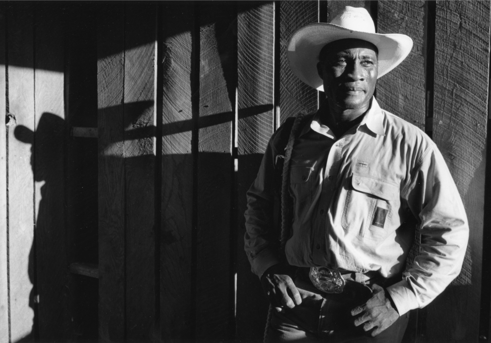"FAMILY: A Portrait of Gay and Lesbian America:  Cowboy T. J. Smith from Okalhoma was photographed on the gay rodeo circuit in 1993.  People used to look at his picture and question, ""He's gay????"" © Nancy Andrews"
